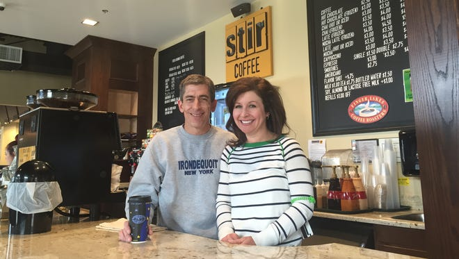 Mike and Wendy Nolan of Irondequoit, proprietors of I-Square at their Stir Coffee counter.