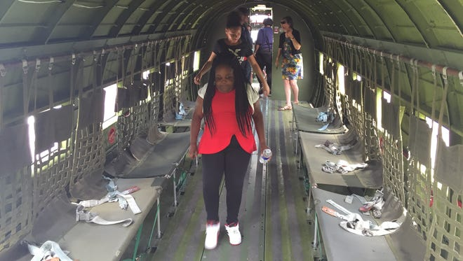Students from School No. 8 tour the Whiskey 7, a restored troop carrier that participated in the D-Day invasion. The tour was part of a new interactive exhibit at the National Warplane Museum in Geneseo.