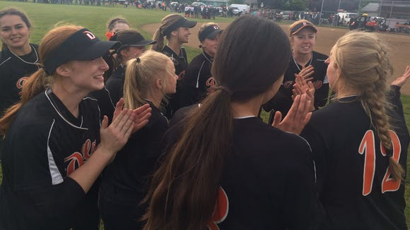 The Dallas softball team celebrates beating Silverton on Tuesday to reach the OSAA Class 5A state championship game.