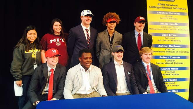 Kentucky Country Day announced a nine-member signing class on Wednesday. Front row, from left, are Mick Smith (Wabash football), Chris Scott (undecided), Jackson Diaz (Pomona football) and Ashton Robinson (MIT football). Back row, from left, are Caroline Dishman (Centre tennis), Lilly Papalia (MIT track and field), Josh Lifson (Air Force football), Gianni Minor (Wabash football) and Robert Thomas (Chicago football).. Jordan West (Louisville football, walk-on) was unable to attend.