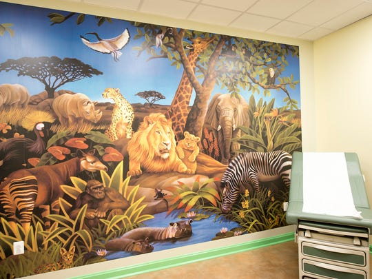 Animal-themed wallpaper covers a wall in the exam room for pediatric patients at ExpressCare Urgent Care Center in Red Lion.