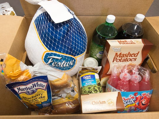 A Thanksgiving food box contains the fixings for dinner