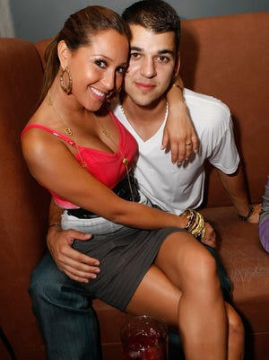 """Adrienne Bailon and Rob Kardashian attend the """"Maxim Celebrates the Biggest Event in Extreme Sports"""" at the Stork on July 31, 2008 in Los Angeles, California.  (Photo by Michael Buckner/Getty Images)"""