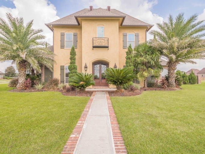This 5 bedroom, 3 1/2 bath home is located at 201 Saddleback