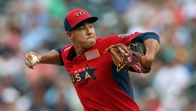 USA pitcher Robert Stephenson throws a pitch in the 8th inning during the All Star Futures Game at Target Field.