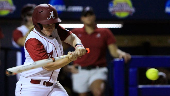 Alabama's Molly Fichtner gets a hit against Oklahoma during the second inning of an NCAA Women's College World Series softball tournament game in Oklahoma City.
