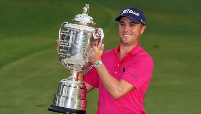 Aug 13, 2017; Charlotte, NC, USA; Justin Thomas celebrates with the Wanamaker Trophy after winning the 2017 PGA Championship at Quail Hollow Club. Mandatory Credit: Kyle Terada-USA TODAY Sports