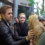 """Ryan Gosling and Rachel Evan Wood meet a sloth at the Cincinnati Zoo during a break from filming """"The Ides of March"""" in 2011."""