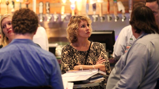 Artmosphere owner Beryl Kemp and other downtown Lafayette business owners attend a downtown code review meeting Tuesday, March 10, 2015, at Jefferson Street Pub in Lafayette, La.