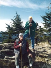 Joe Hemphill, front, and Robert Goodson at the peak of Mount Mitchell during one of their many hikes.
