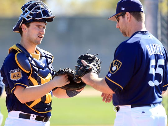 Andrew Susac (left), working with bullpen catcher Marcus