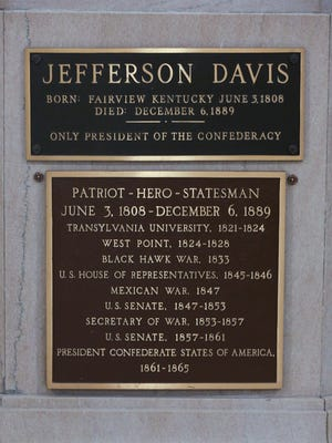 """A plaque in front of the Jefferson Davis statue inside the Kentucky State Capitol rotunda states that he is a """"Patriot-Hero-Statesman.""""  Sep. 20, 2017"""