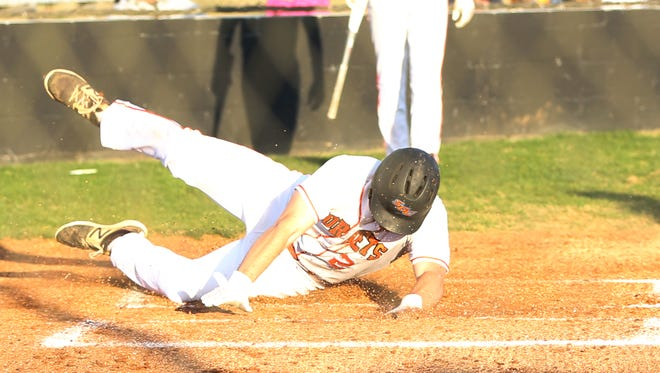 South Gibson's Levi Schlesinger (2) slides through home plate for the first run of the game against Crockett County on April 16, 2018.