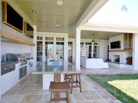 The outdoor kitchen and living  area are perfect for
