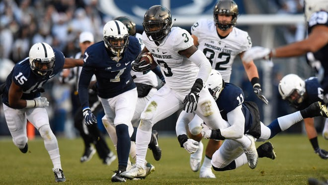 Michigan State Spartans running back LJ Scott (3) runs with the ball against the Penn State Nittany Lions during the first quarter at Beaver Stadium.