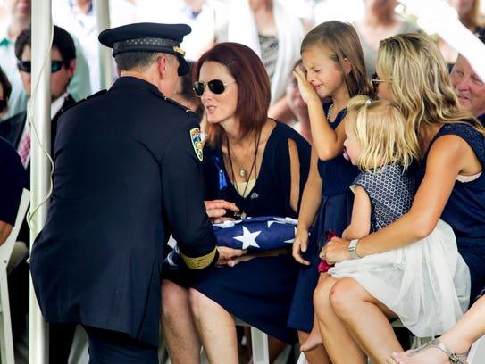 Dechia Badeaux Gerald, wife of Officer Matthew Gerald-