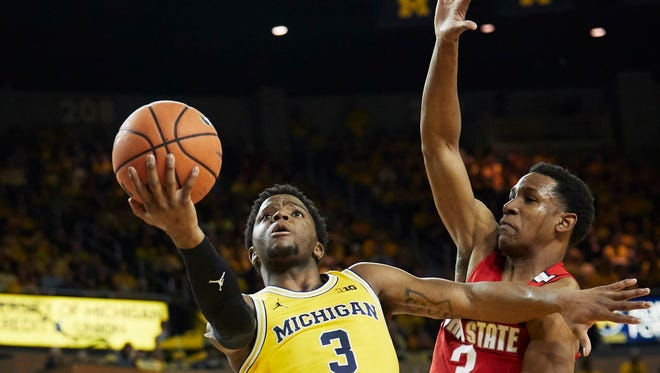 Michigan's Zavier Simpson goes to the basket against Ohio State's C.J. Jackson on Feb. 18 at Crisler Center.