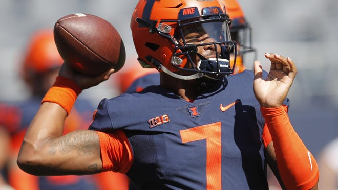 Illinois quarterback Coran Taylor warms up prior to an NCAA college football game against South Florida Saturday, Sept. 15, 2018, in Chicago.