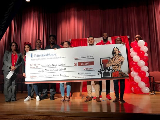 Immokalee grad Edgerrin James and Giants cornerback Dominique Rodgers-Cromartie present Immokalee High School with a $20,000 to Immokalee High School on Wednesday. UnitedHealthcare, along James and Giants cornerback Rodgers-Cromartie, donated to help the athletic department recoup lost revenue from Hurricane Irma.
