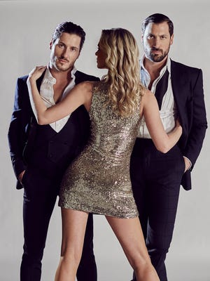 Maks & Val pose with an unidentified model.