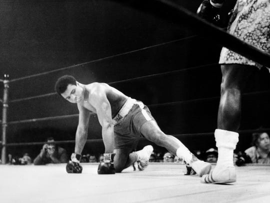 A picture taken March 08 1971 in New York at the Madison Square Garden of the heavyweight boxing world championship fight between Muhammad Ali (Cassius Clay) (on the floor) and Joe Fazier at the end of which Frazier kept his title of heavyweight boxing world champion.        (Photo credit should read -/AFP/Getty Images)