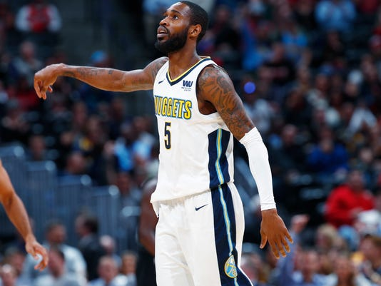 Denver Nuggets guard Will Barton reacts after hitting a three-point basket against the Chicago Bulls in the first half of an NBA basketball game Thursday, Nov. 30, 2017, in Denver. (AP Photo/David Zalubowski)