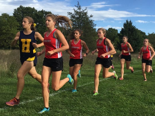 Leading the pack early in the girls' race are (from left) Hartland's Michelle Moraitis, and Pinckney's Isabella Garcia, Mia Garcia, Noelle Adriaens, Mackenzie Carano and Courtney Jarema. Isabella Garcia won in 19:37.5.