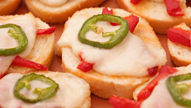 Melted Roasted Red Pepper-Mozzarella Toasts with Fresh Jalapeno.