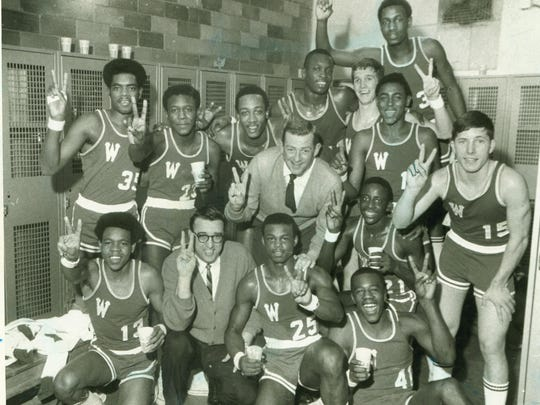 The 1969 Washington Continentals team after defeating Shortridge in the regional semifinals March 8, 1969. Front row, from left: Harvey Galbreath, Assistant Coach Basil Sfreddo, Louie Day and Steve Stanfield; middle row, Coach Bill Green, Wayne Pack and Alan Glaze; back row, Ken Carter, Abner Nibbs, George McGinnis, Steve Downing, James Arnold, James Riley and Kenneth Parks.
