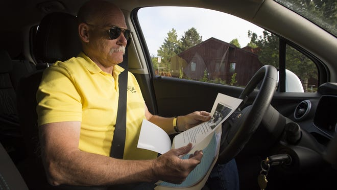 Dale Wood, senior compliance inspector with the city of Fort Collins, goes through evidence for occupancy investigation in the Golden Meadows neighborhood at the start of June.