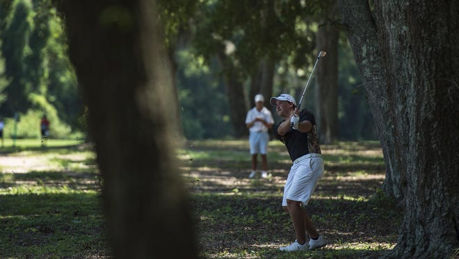Henry Westmoreland IV drives out of the woods during the Oglethorpe Invitational golf tournament Saturday, July 23, 2016, in Wilmington Island, Ga.