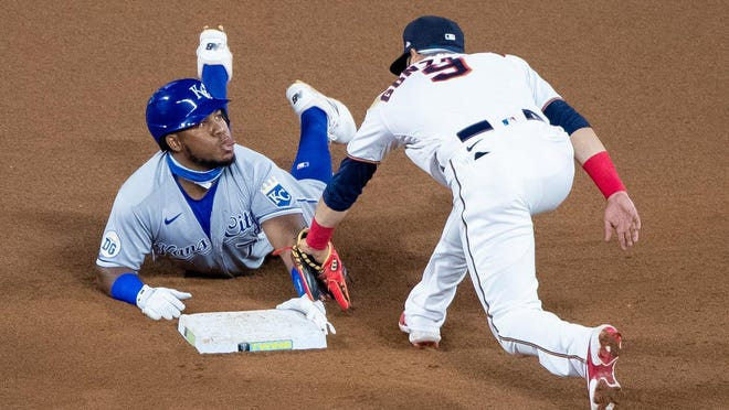 Kansas City Royals third baseman Maikel Franco (7) sticks his tongue out at Minnesota Twins second baseman Marwin Gonzalez (9) after sliding in safely with a double in the seventh inning of Monday's game at Target Field. The Royals lost 4-1.