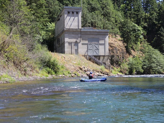 Mike Babcock paddles just past the old powerhouse of Condit Dam on the White Salmon River. The dam was removed in 2011 and the old powerhouse is one of the only remaining structures.