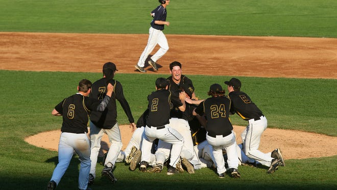 Honeoye Falls-Lima players celebrate on the pitcher's mound after a 14-6 defeat of Brighton to win the Class A championship.