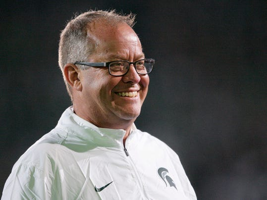 FILE - In this Sept. 12, 2015, file photo, Michigan State's director of athletics, Mark Hollis smiles during an NCAA college football game against Oregon in East Lansing, Mich. The selection committee for the NCAA men's basketball tournament is getting into the bracketology business and borrowing an idea from the College Football Playoff, hoping it will get more fans thinking about March Madness in February. The NCAA and CBS Sports announced Tuesday, Jan. 24, 2017, that for the first time the committee will give a look at its top 16 seeds one month before the 68-team field locks in on March 12. Committee head Mark Hollis is scheduled to take part in the reveal show. (AP Photo/Al Goldis, File)