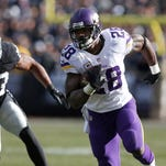 Minnesota Vikings running back Adrian Peterson (28) runs from Oakland Raiders linebacker Malcolm Smith (53) during the first half of an NFL football game in Oakland, Calif., Sunday, Nov. 15, 2015. (AP Photo/Beck Diefenbach)