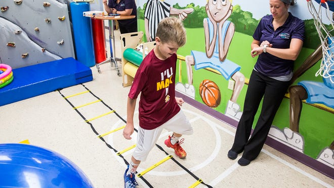Tyler Aul completes ladder drills at Meridian Pediatric Rehab in Muncie Wednesday morning.