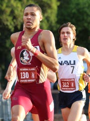 """On his left wrist you can see Michael Hall's white """"Telestai"""" bracelet and on his right wrist is his """"What Would Jesus Do"""" bracelet. The FSU senior says he never takes them off."""