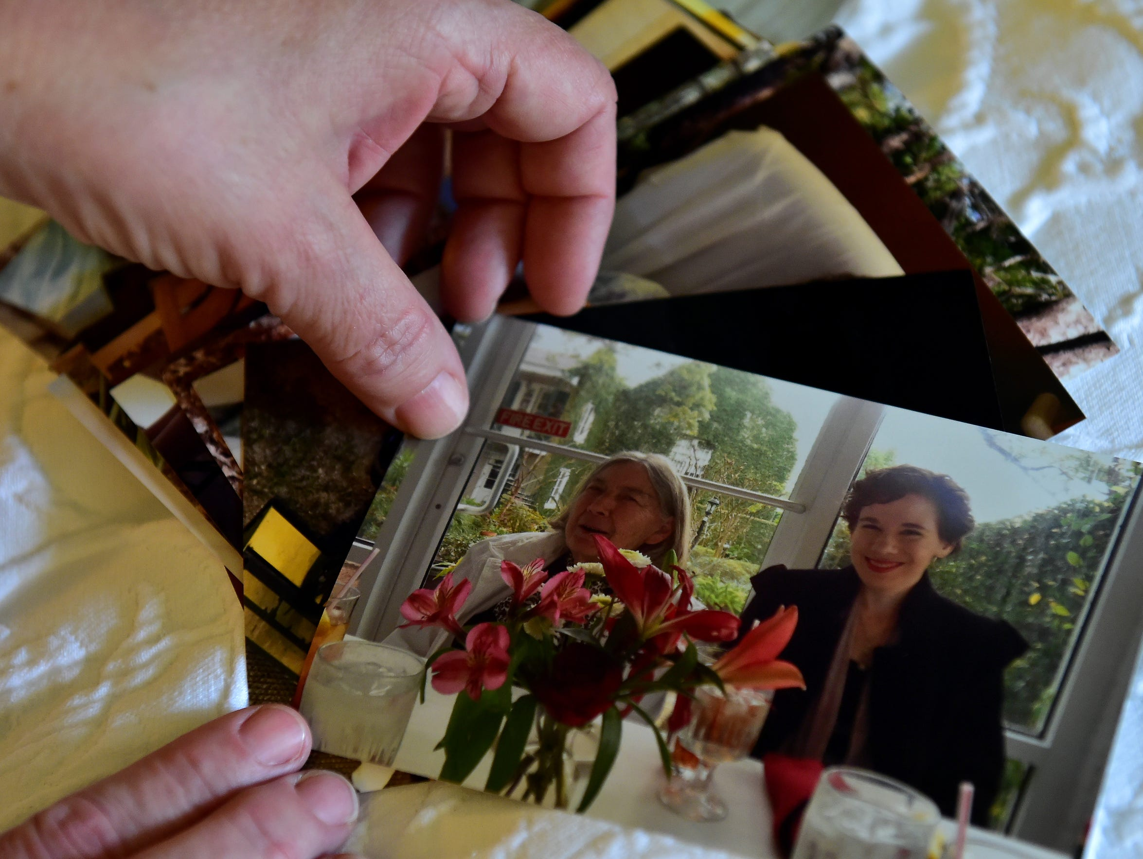 Lisa Conner looks at a photo of her daughter Brooke and her grandmother taken Feb. 24, 2015, just two weeks before a reaction to changes in medication landed her in the hospital.