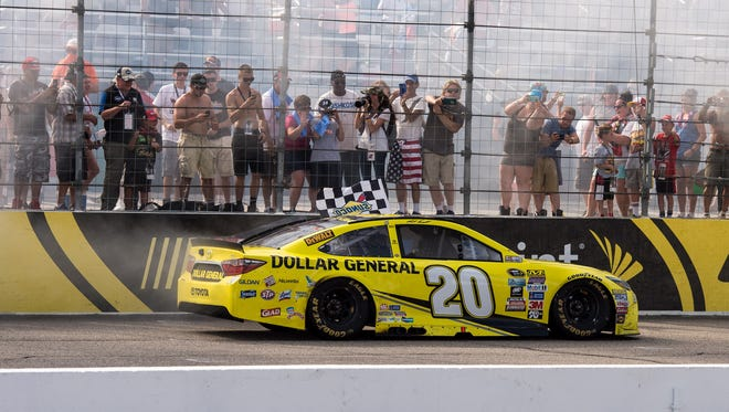 Matt Kenseth celebrates wining the New Hampshire 301 Sunday at New Hampshire Motor Speedway.