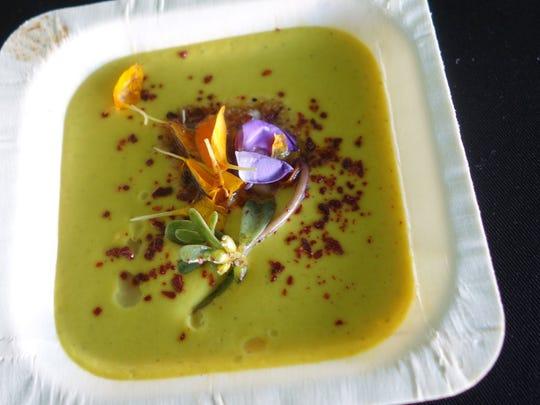 Butternut squash soup with edible flowers, hazelnut