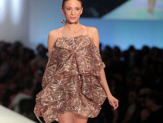 Model wearing Justin Leblanc's design walks the runway