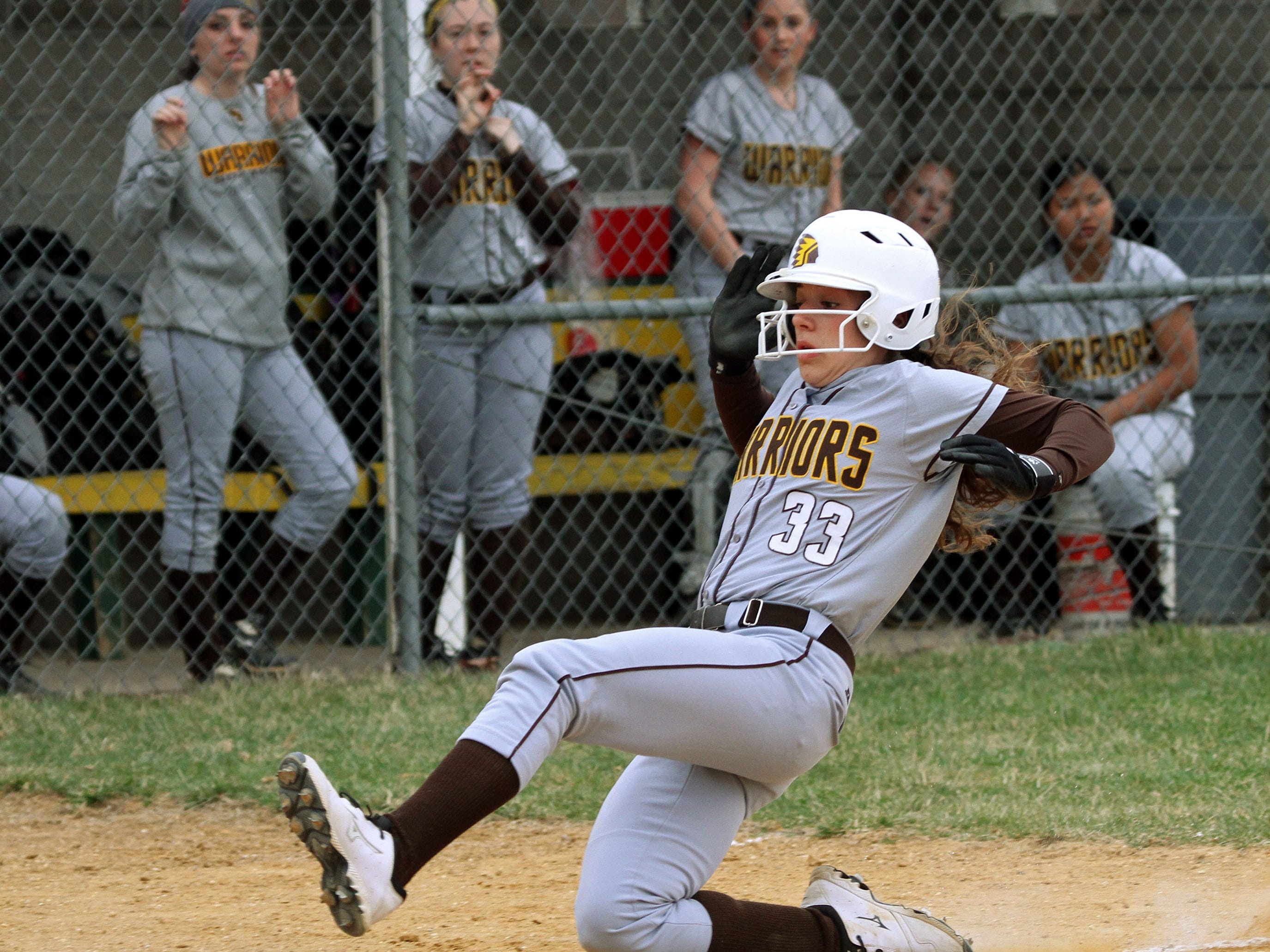 Watchung Hills' Nicole Carroccia slides in safely to home. This is action of Watchung Hills at Montgomery in girls softball.
