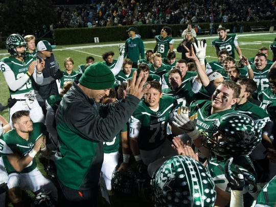 Greeneville head coach Caine Ballard and his team celebrate their 35-31 win over Anderson County on Friday, November 17, 2017.