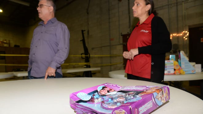 A Disney activity with damaged packaging is among some of the leftover toys from last Christmas at The Salvation Army Vineland Corps, where Majors Miguel and America Barriera talk about the need for more.