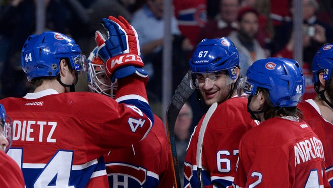 Montreal Canadiens forward Max Pacioretty (67) celebrates with teammates including Sven Andrighetto (42) after defeating the Detroit Red Wings at the Bell Centre.
