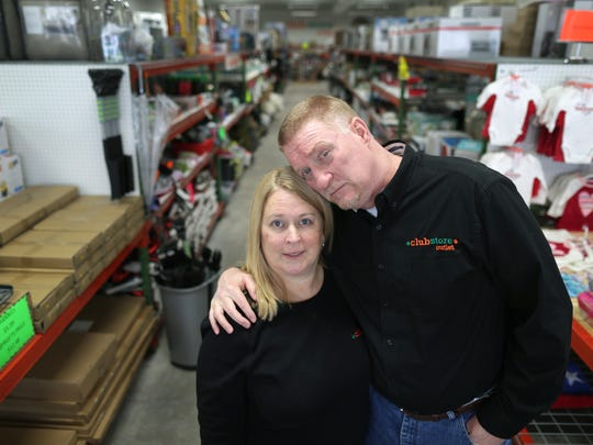 Bruce and Cindy Schooley posed for a photo at their Clubstore Outlet in Neenah before the store closed in March.