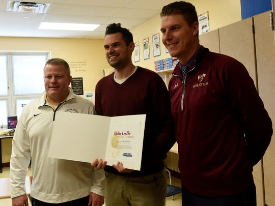 Licking Heights teacher Sean McCullough (center) with Heights assistant principal David Moore (left) and principal Kenneth Kraemer after being awarded a Tibbie Leslie Travel Grant by the Licking County Foundation.