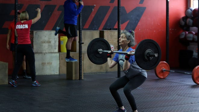 Loni Ackerman Kennedy, 67, of Upper Grandview during a workout at CrossFit Momentum in Nyack, Oct. 25, 2016. Ackerman Kennedy, a former dancer, has been doing CrossFit for two years and says she loves the workout because it is parallel to a great dance class.