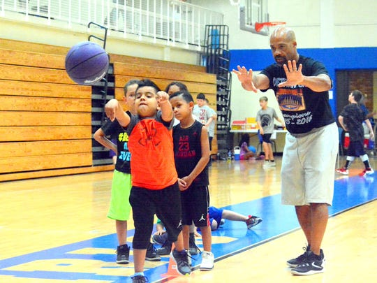 Chest-passing drills during the Cavemen basketball camp on Wednesday.